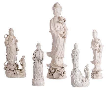 Five Blanc de Chine figures of a Guanyin, H 30,5 - 56 cm