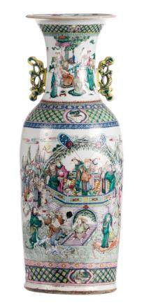 A Chinese famille rose and polychrome vase, overall decorated with immortals, 19thC, H 61,5 cm (chips to the top rim)