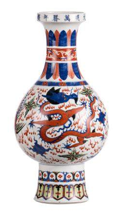 A Chinese wucai bottle vase, overall decorated with dragons and phoenix, with a Wanli mark, H 51 cm
