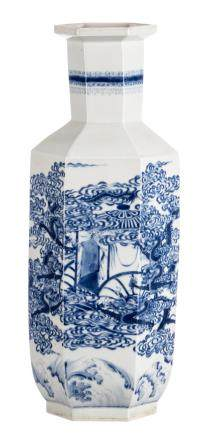 A Chinese blue and white hexagonal vase, overall decorated with dragons, marked with a Qianlong mark, H 66 cm