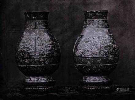 A RARE AND IMPORTANT PAIR OF LARGE BRONZE-IMITATION VASES SEAL MARKS AND PERIOD OF QIANLONG