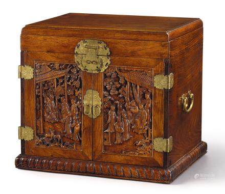 A 'HUANGHUALI' DRESSING CASE WITH CARVED DOORS AND GILT-BRONZE FITTINGS LATE MING – EARLY QING DYNASTY