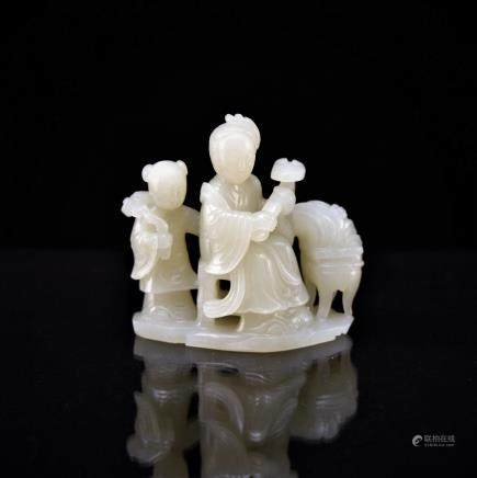 CARVED JADE IN SHAPE OF FIGURES HOLDING RUYI