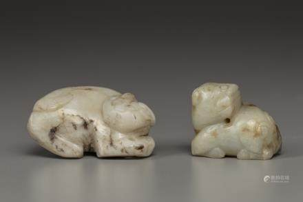 A creamy jade water buffalo and a celadon and russet jade Buddhist lion