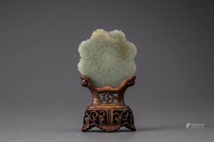 A celadon jade floral plaque