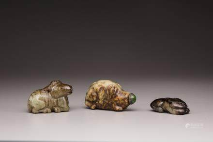 Two jade animal carvings and a jade snuff bottle