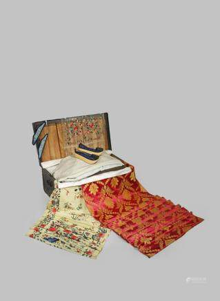 A COLLECTION OF CHINESE TEXTILES AND A TRUNK