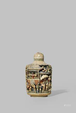 λ A LARGE CHINESE STAINED IVORY SNUFF BOTTLE