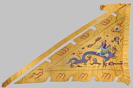 A CHINESE YELLOW SILK TRIANGULAR DRAGON FLAG