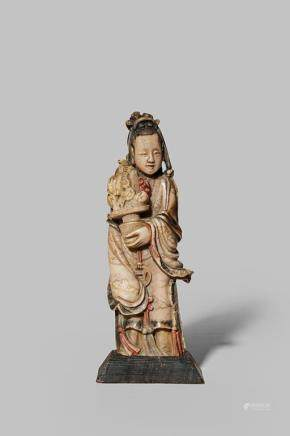 A CHINESE SOAPSTONE FIGURE OF MAGU