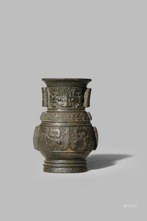 A SMALL CHINESE BRONZE ARCHAISTIC VASE