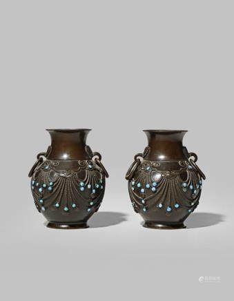 A PAIR OF CHINESE SMALL BRONZE VASES