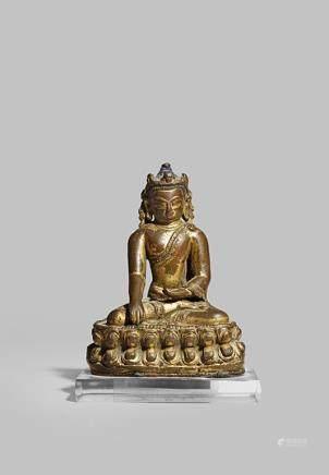 A SMALL TIBETO-CHINESE GILT BRONZE FIGURE OF BUDDHA
