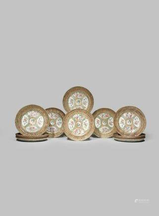 A SET OF TWELVE CHINESE CANTON FAMILLE ROSE PLATES