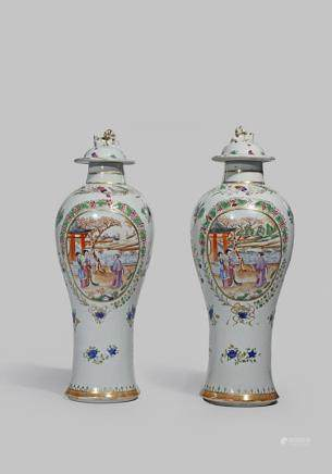 A PAIR OF CHINESE FAMILLE ROSE SLENDER BALUSTER VASES AND COVERS