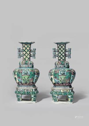 A PAIR OF CHINESE FAMILLE VERTE VASES AND STANDS