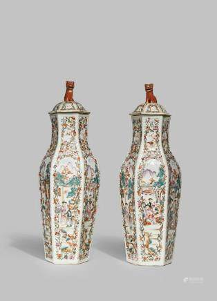 A PAIR OF CHINESE FAMILLE ROSE HEXAGONAL VASES AND COVERS