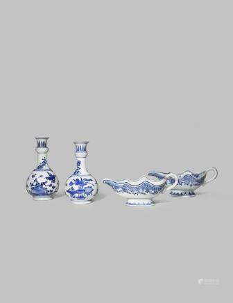 A NEAR PAIR OF CHINESE BLUE AND WHITE VASES AND TWO SAUCE BOATS