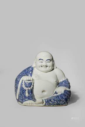 A CHINESE BLUE AND WHITE FIGURE OF BUDAI HE SHANG