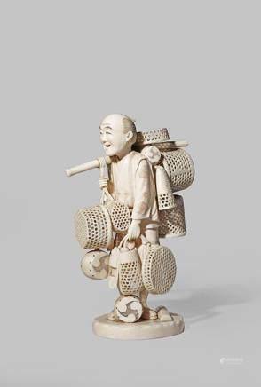 λ A JAPANESE IVORY OKIMONO