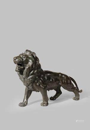A JAPANESE BRONZE OKIMONO OF A LION