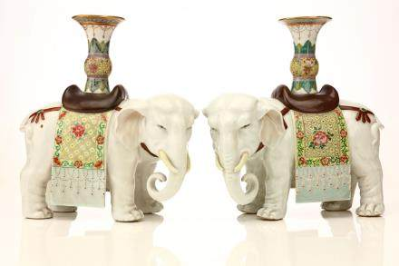 A PAIR OF CHINESE FAMILLE ROSE €˜ELEPHANT€™ CANDLE STICKS