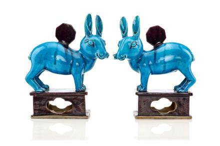 A PAIR OF CHINESE TURQUOISE AND AUBERGINE GLAZED MOON HARES