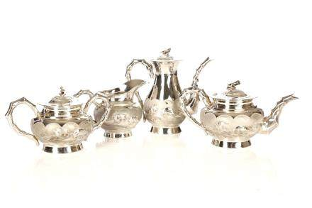 A CHINESE EXPORT SILVER FOUR PIECE €˜MOON HARES€™ TEA SET
