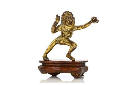 A TIBETAN MINIATURE BRONZE FIGURE OF A DAKINI