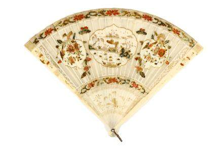 A CHINESE CARVED IVORY FAN
