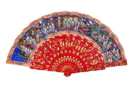 A CHINESE RED AND GILT IVORY FAN