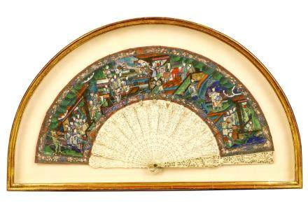 A CHINESE CANTON CARVED IVORY BRISÉ FAN WITH PAINTED LEAF