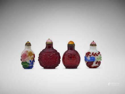 Four Chinese carved glass snuff bottles