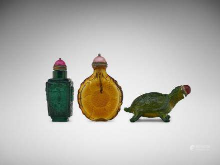 Three Chinese carved glass snuff bottles