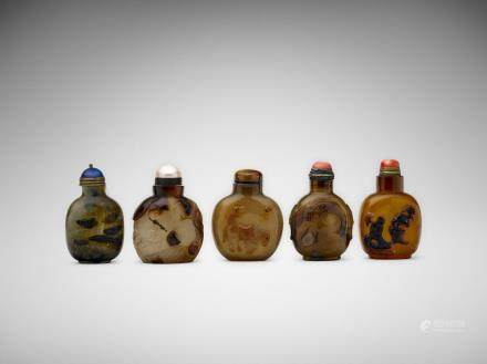 A group of five Chinese hard stone snuff bottles