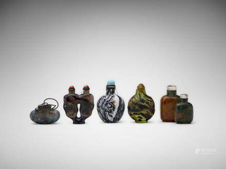 A group of five Chinese snuff bottles of glass and hard stone