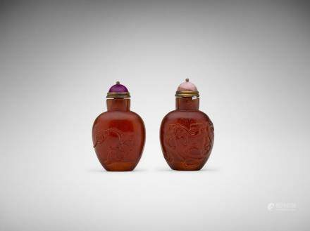 Two Chinese carved amber snuff bottles