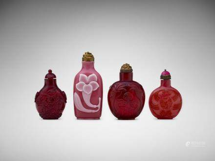 A group of four Chinese red and pink glass snuff bottles