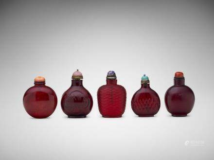 Five Chinese carved ruby-glass snuff bottles