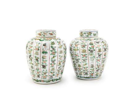 A pair of famille verte jars and covers
