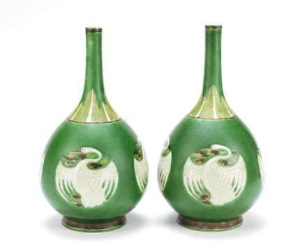 A pair of famille verte biscuit 'cranes' bottle vases