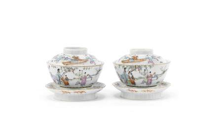 A pair of famille rose bowls, covers and stands