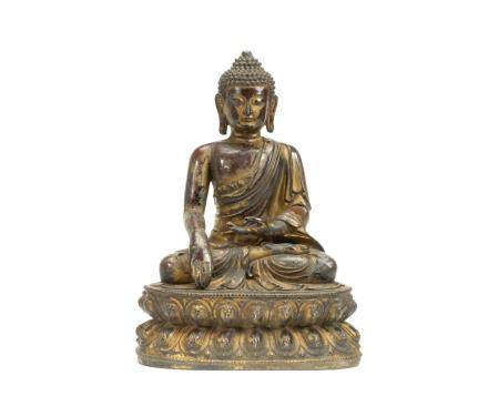 A large gilt-lacquered bronze figure of Buddha