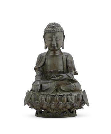 A large bronze figure of the Medicine Buddha on a lotus stand