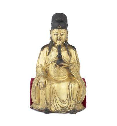 A large gilt-bronze figure of the King of Medicine, Yaowang