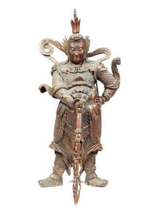 A large gilt-lacquered wood figure of a guardian deity