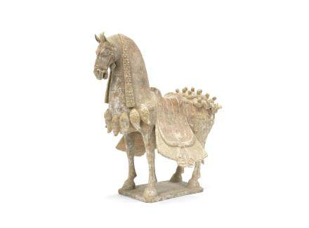 A painted pottery model of a caparisoned horse
