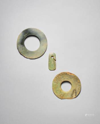 Two jade discs, bi, and an ear ornament