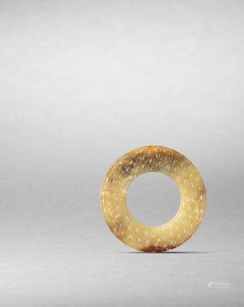 A yellow jade disc, bi