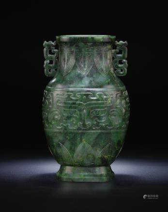 A rare spinach-green jade archaistic baluster vase, hu